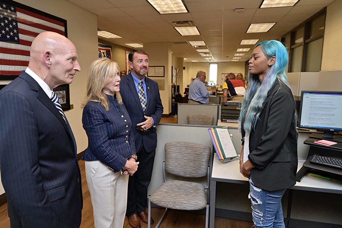 Kwantisha Avila, right, a sophomore criminal justice major from Austin, Texas, shares about her student-veteran life and that of a former U.S. Marine sergeant to Keith M. Huber, left, U.S. Sen. Marsha Blackburn and John Clement, field director in Blackburn's office, during a Friday, June 21, visit to MTSU. (MTSU photo by Andy Heidt)