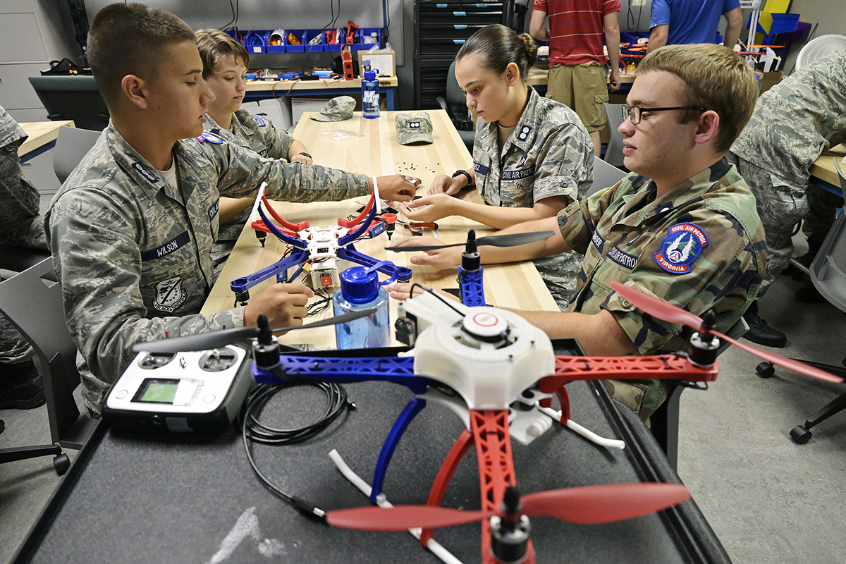 Civil Air Patrol cadets Josh Wilson, left, Ravyn Weirich, Madeline Perez and Gage Hunsinger combine efforts to make an unmanned aircraft, or drone, during the 2019 CAP National Engineering Camp. (MTSU photo by Andy Heidt)