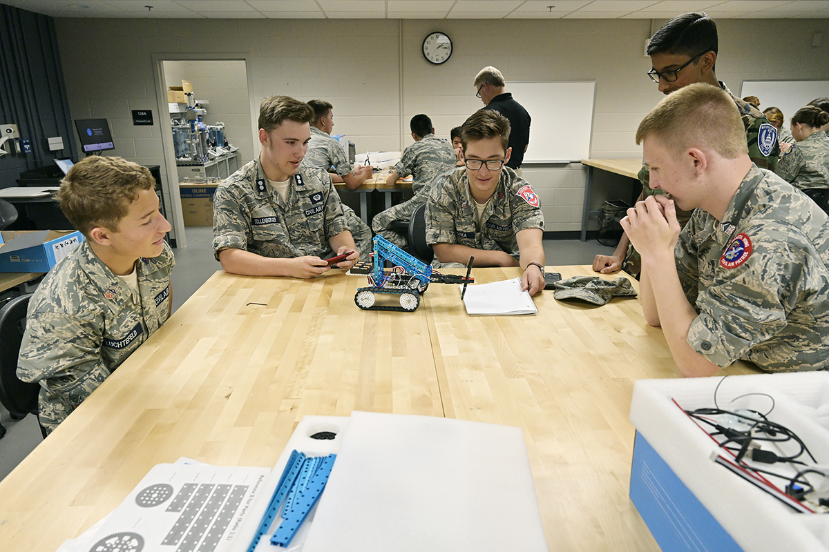 A group of Civil Air Patrol cadets work with robots from MTSU's mechatronics engineering program Tuesday, June 25, in Davis Science Building during the 2019 CAP national E-Tech Engineering Academy. (MTSU photo by Andy Heidt)