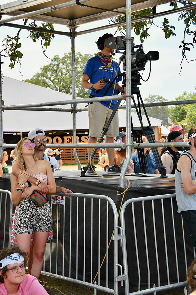 Johanns Frederick Litzenberger-Rivera, a MTSU video production junior, shoots video from a platform Sunday, June 16, at Bonnaroo's Who Stage in Manchester, Tenn. (MTSU photo by Andrew Oppmann)