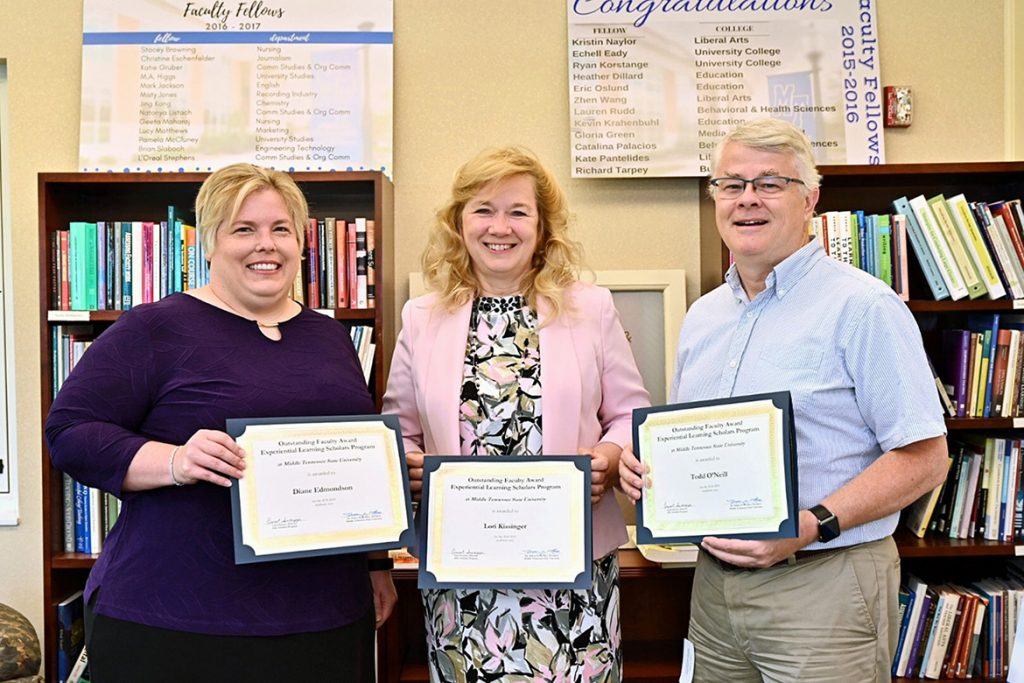 Winners of the 2019 MTSU Outstanding Faculty Awards from the university's Experiential Learning Program display the honors bestowed upon them June 11 at the EXL Institute in Walker Library. Pictured, from left, are Diane Edmondson, an associate professor of marketing; Lori Kissinger, an instructor of communication studies; and Todd O'Neill, an assistant professor of media arts. Winners Laura Buckner and Jane Lim were not able to attend. (MTSU photo by J. Intintoli)