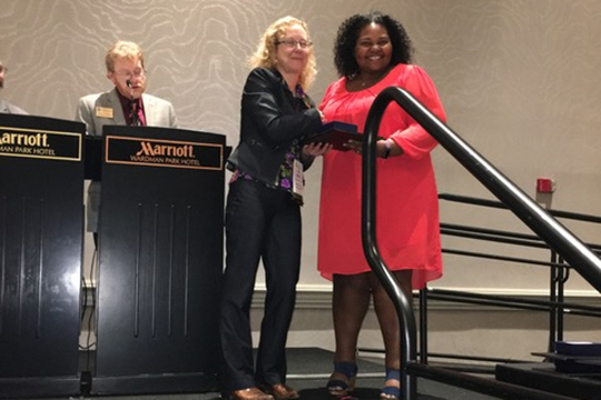 Dr. LaToya Eaves, right, an assistant professor in Global Studies and Human Geography at MTSU, received the American Association of Geographers' 2019 Ronald F. Abler Distinguished Service Honors award as well as the AAG Enhancing Diversity Award. Eaves received the awards at the association's luncheon earlier this spring in Washington, D.C. (Submitted photo)