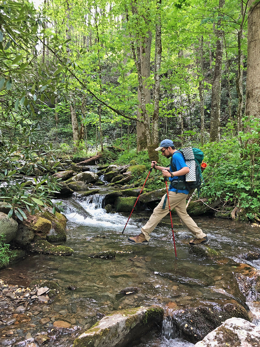 MTSU class member Elman Gonzales utilizes hiking poles to cross a creek near the Little River Trail in the Great Smoky Mountains National Park on a recent visit to the area's backcountry. (Submitted photo by Ashley Morris)