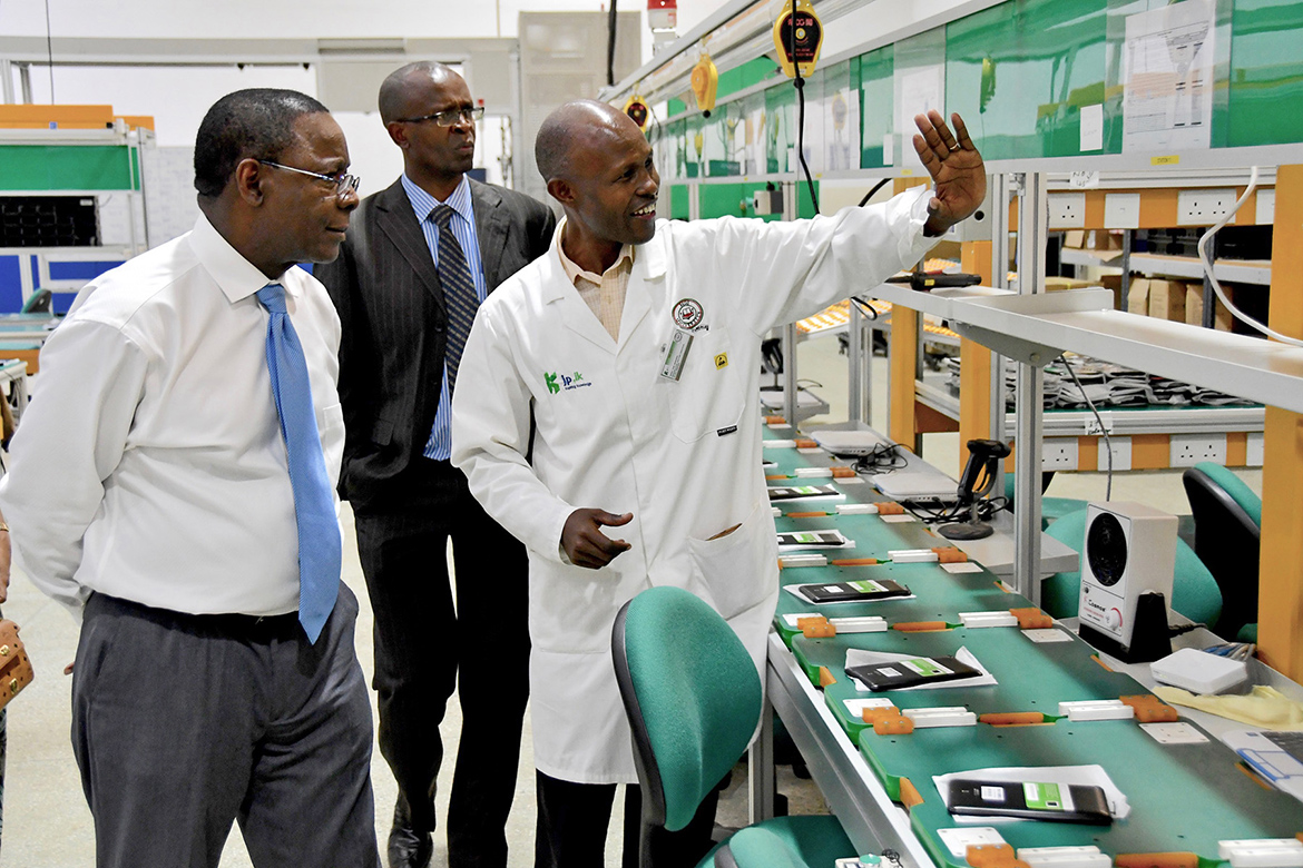 Faculty members from Moi University give MTSU President Sidney A. McPhee, left, a tour of a digital assembly plant that the Kenyan institution operates. (MTSU photo by Andrew Oppmann)