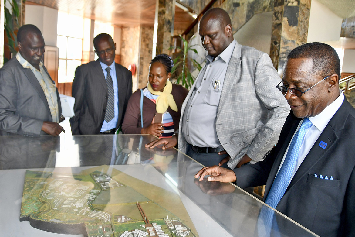 Isaac Kosgey, second from right, chief executive officer of Moi University in Kenya, gives MTSU President Sidney A. McPhee an overview of his campus from a tabletop model. (MTSU photo by Andrew Oppmann)