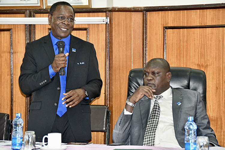 MTSU President Sidney A. McPhee speaks to the Faculty Senate at Moi University in Kenya as Isaac Kosgey, right, Moi's chief executive officer, listens. (MTSU photo by Andrew Oppmann)