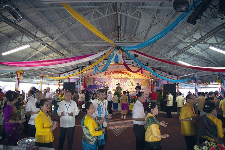 MTSU faculty and staff take part in a traditional Laotian dance with community members and attendees held May 25 at the Wat Lao Buddharam temple in Murfreesboro. (Submitted photo)