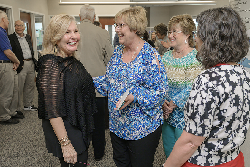 From left, Lucinda Taylor Lea, vice president emeritus of MTSU's Information Technology Division, chats with Debbie Warren, ITD systems analyst; Joann Batson, ITD systems analyst; and Janae Peterson, ITD systems analyst, on June 17 at the dedication ceremony for the Lucinda Taylor Lea Learning, Teaching and Innovative Technologies Center. The center is located on the third floor of the James E. Walker Library. (MTSU photo by Andy Heidt)