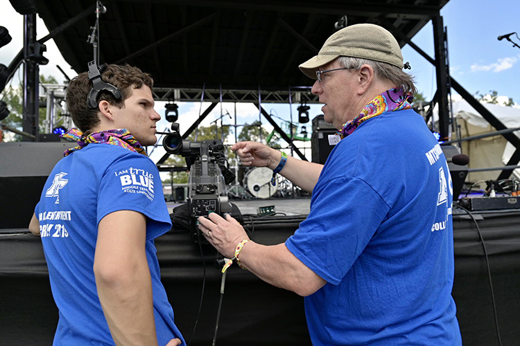 Johanns Frederick Litzenberger-Rivera, left, a junior MTSU video production major, talks camera angles with Robert Gordon Jr., an associate professor in Media Arts, before shows started Thursday on the Who Stage at Bonnaroo in Manchester, Tenn. (MTSU photo by Andy Heidt)