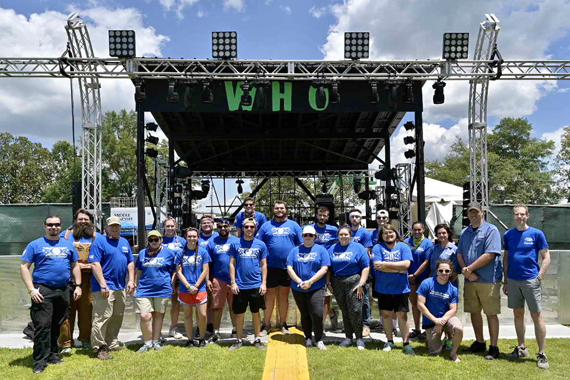 Audio and video production students from MTSU's College of Media and Entertainment assemble in front of the Who stage at the Bonnaroo Music and Arts Festival in Manchester, Tenn., before beginning work Thursday to record performances at the venue. (MTSU photo by Andy Heidt)
