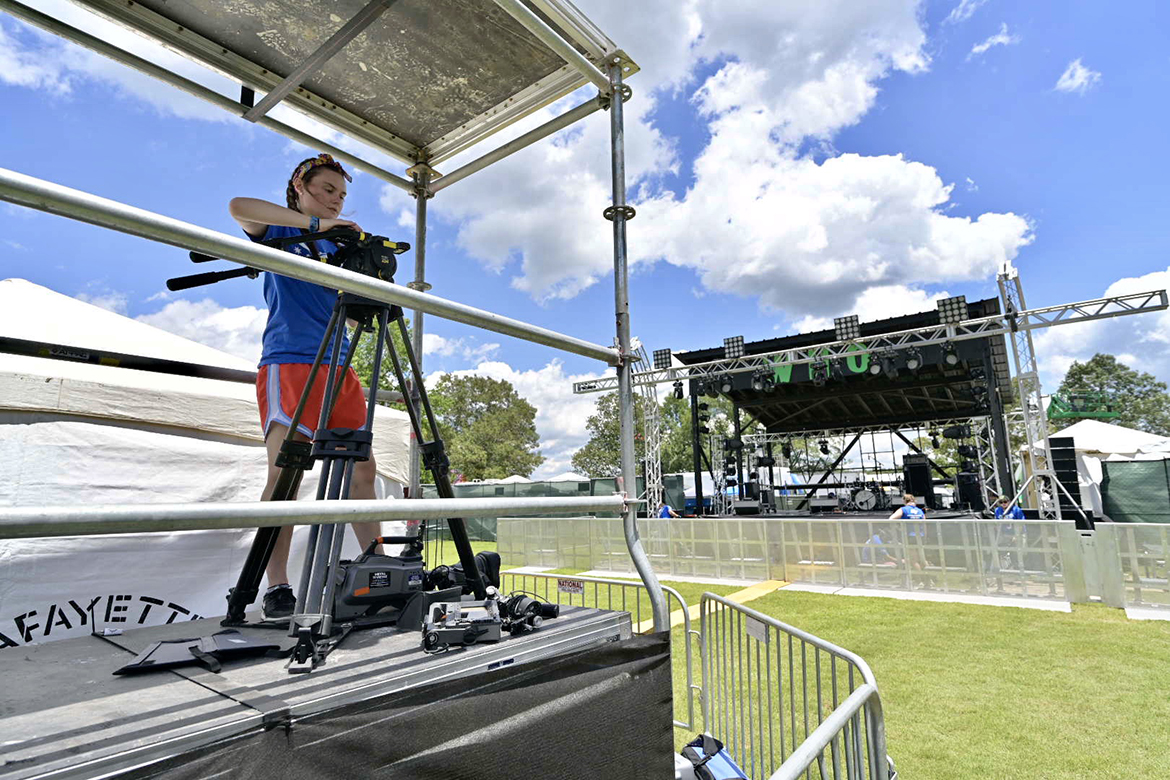 Brea Robbins, a MTSU junior in video production, gets her camera ready before the shows started Thursday at the Who Stage at Bonnaroo in Manchester, Tenn. (MTSU photo by Andy Heidt)