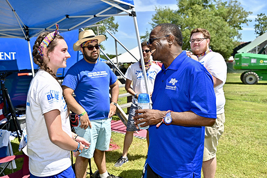 MTSU President Sidney A. McPhee, right, chats with College of Media and Entertainment students Friday, June 14, at the Bonnaroo Music and Arts Festival in Manchester, Tenn. (MTSU photo by J. Intintoli)