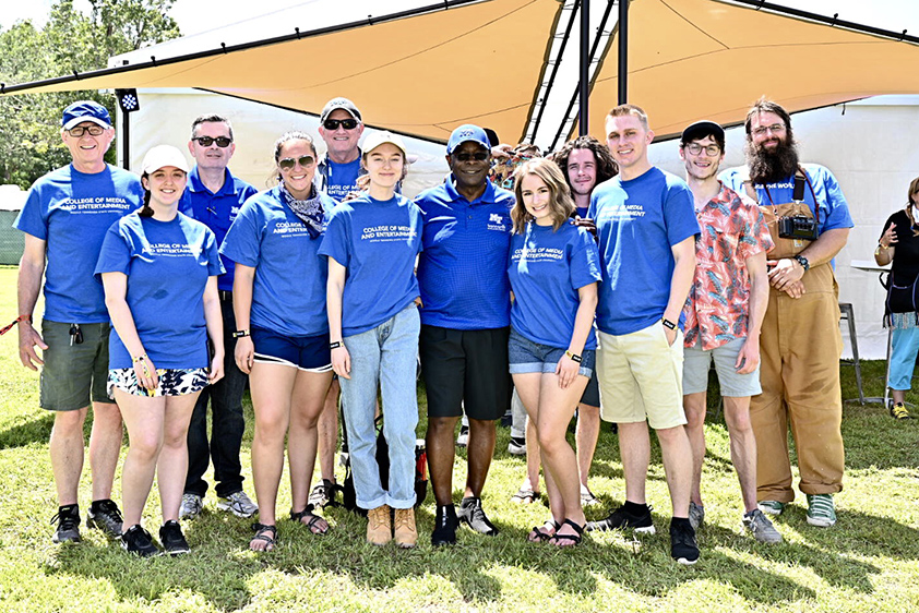 MTSU President Sidney A. McPhee, center, poses with College of Media and Entertainment students and faculty Friday, June 14, at the Bonnaroo Music and Arts Festival in Manchester, Tenn. (MTSU photo by J. Intintoli)