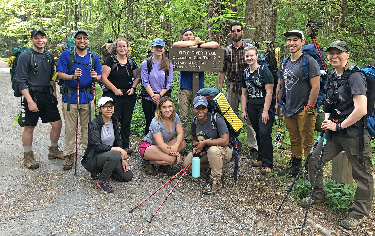 "The inaugural ""SmokyMtnU"" class from MTSU took a break at the Little River Trail and nearby trails in the Great Smoky Mountains National Park during the group's recent visit. In front are Cyerrah Sengaroun, left, Haven Poore and Infiniti Bristol. In back are Cody Keck, Elman Gonzales, associate professor Ashley Morris, Haley Carter, James Beckner, graduate student Lee Rumble, Bekkah Riley Luke Torres and Christine Hoyer, the park's backcountry manager. (Submitted photo by Ashley Morris)"