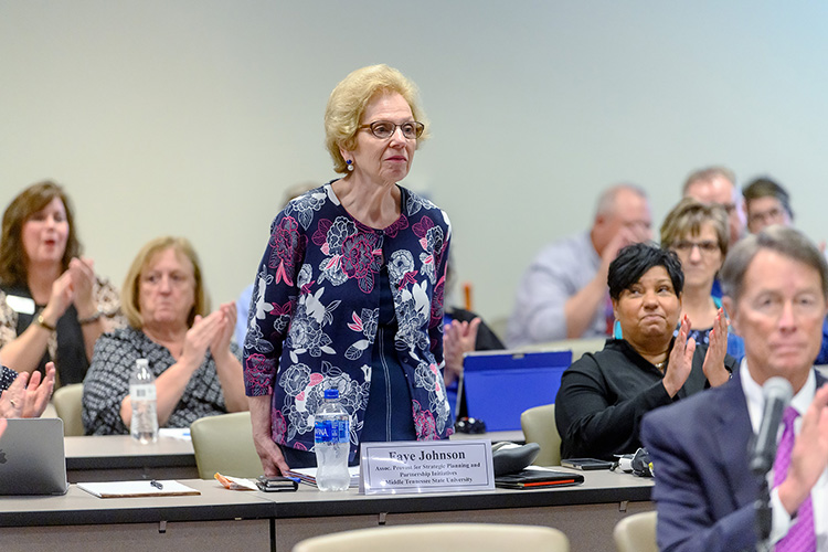 MTSU's Board of Trustees and those attending the Tuesday, June 18, meeting recognize longtime university employee Faye Johnson, associate provost for strategic planning and partnershi initiatives. Johnson is retiring after 50 years of service to the Blue Raider campus. (MTSU photo by J. Intintoli)