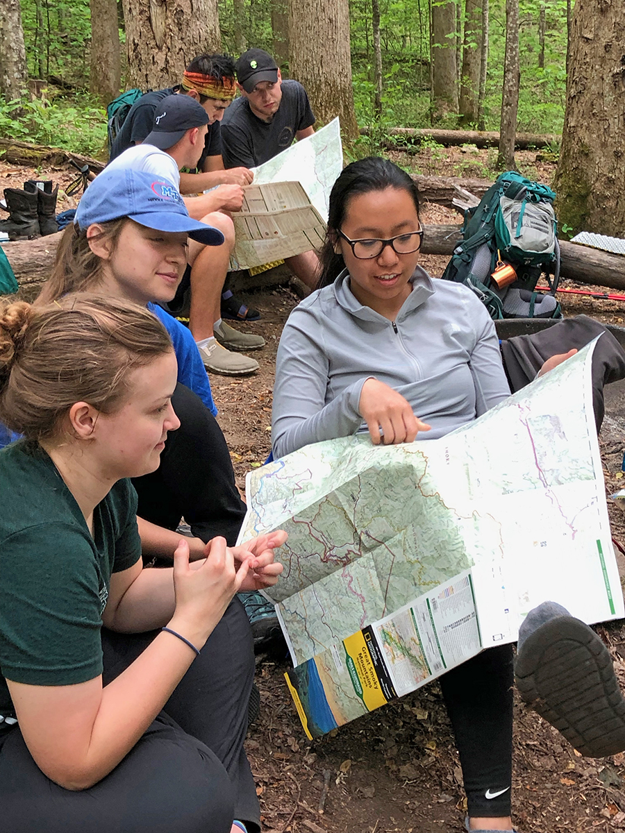 "MTSU students used topographic maps to plan a hypothetical itinerary for future backpacking trips as part of a ""SmokyMtnU"" class assignment during their recent visit to the park and second since March. In foreground are Bekkah Riley, left, Haley Carter and Cyerrah Sengaroun; in background are James Beckner, left, Luke Torres and Cody Keck. (Submitted photo by Ashley Morris)"