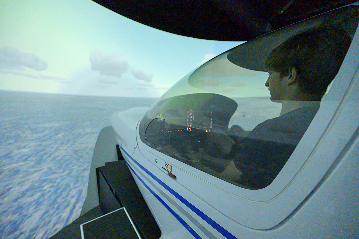 Nathan Fisk, 17, a rising senior at Silverdale Baptist Academy in Chattanooga, Tenn., sits in the pilot's seat and flies the simulator June 12 during the aerospace department's Introduction to Aviation Camp. A total of 36 campers attended the weeklong session. (MTSU photo by Andy Heidt)