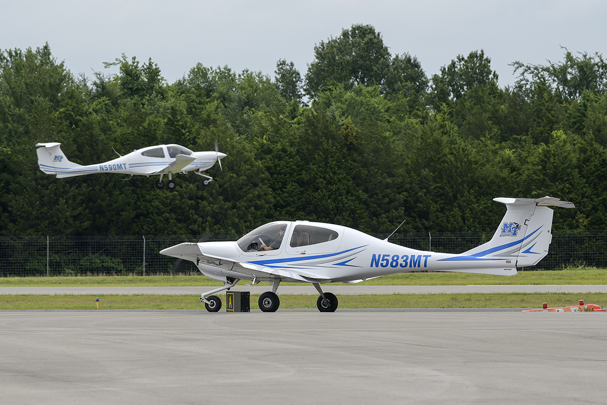 As one plane takes off, another sits on the Murfreesboro Airport tarmac and waits its turn June 12 at the annual Introduction to Aerospace Camp. Participants flew throughout the week and observed other aspects of the aerospace department. (MTSU photo by Andy Heidt)