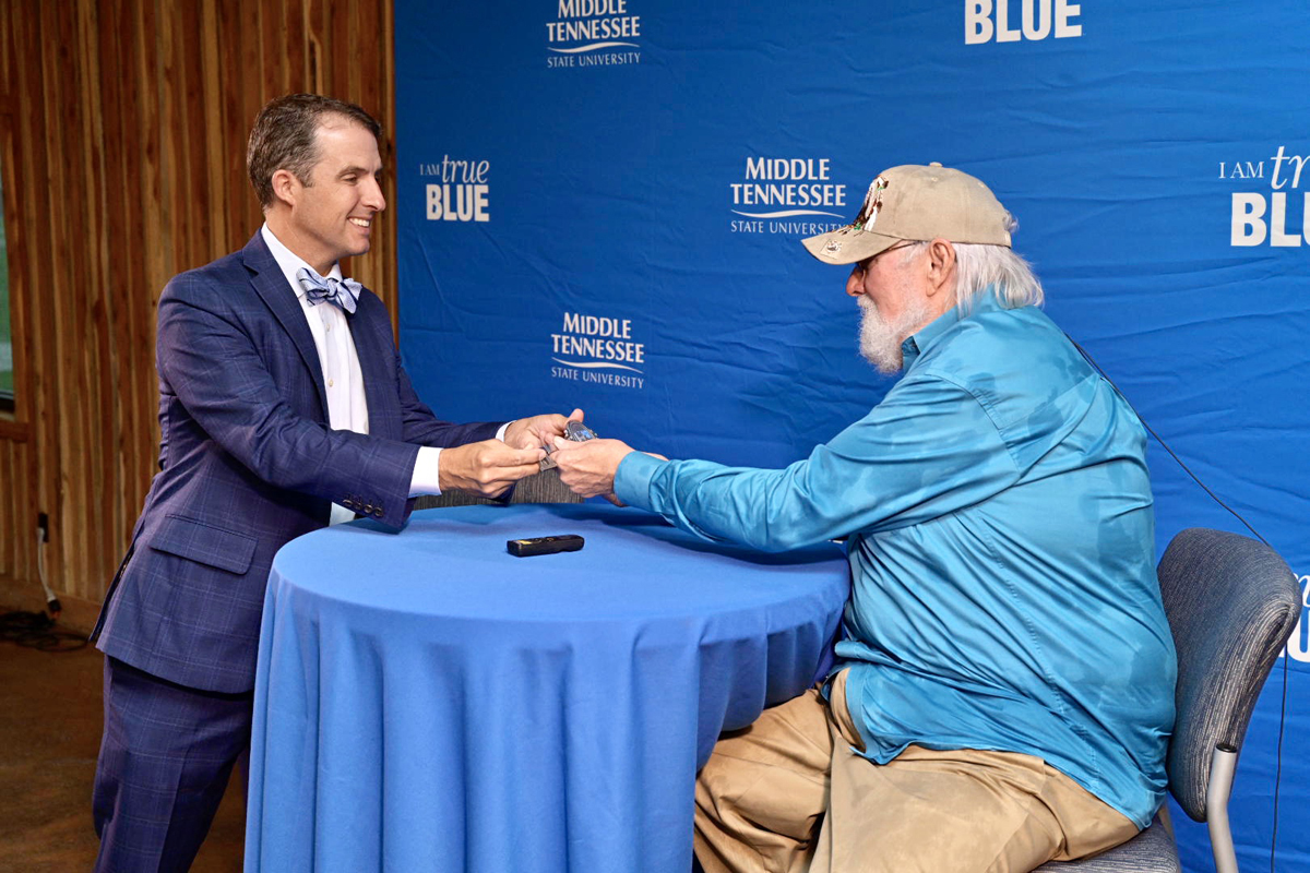 MTSU alumnus and Murfreesboro Mayor Shane McFarland, left, presents Charlie Daniels to the key to the city during the second Veteran Impact Celebration at The Grove at Williamson Place Thursday, June 27. The event is a fundraiser for the MTSU Charlie and Hazel Daniels Veterans and Military Family Center. (MTSU photo by Andy Heidt)