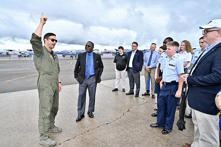 U.S. Air Force Maj. Garret Schmitz, left, commander of the F-16 Viper Demonstration Team, speaks to MTSU President Sidney A. McPhee, second from left, and a university-led contingent visiting Smyrna Airport Friday for the last practice before the scheduled Great Tennessee Air Show this weekend. (MTSU photo by J. Intintoli)