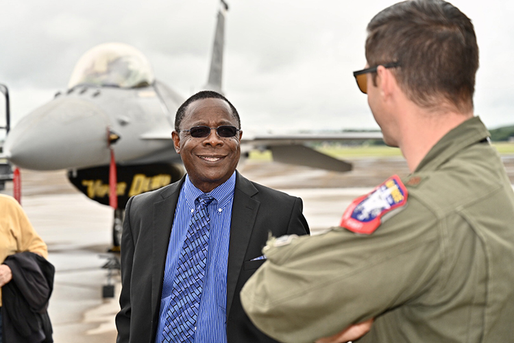 MTSU President Sidney A. McPhee, center, speaks with U.S. Air Force Maj. Garret Schmitz, commander of the F-16 Viper Demonstration Team, at Smyrna Airport Friday for the last practice before the scheduled Great Tennessee Air Show this weekend. (MTSU photo by J. Intintoli)