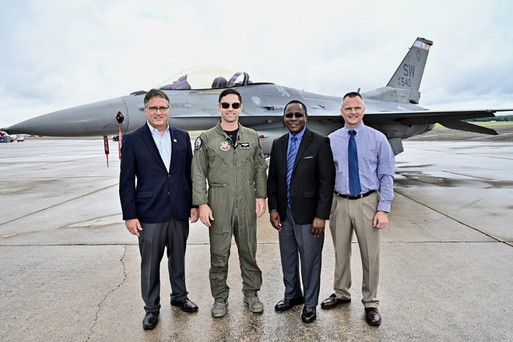 The U.S. Air Force's Air Combat Command F-16 Viper Demonstration Team hosted an MTSU contingent for the final practice Friday before the Great Tennessee Air Show this weekend at Smyrna Airport. Pictured, from left, are University Provost Mark Byrnes; U.S. Air Force Maj. Garret Schmitz, commander of the Viper team; MTSU President Sidney A. McPhee; and Alan Thomas, MTSU vice president for business and finance. (MTSU photo by J. Intintoli)
