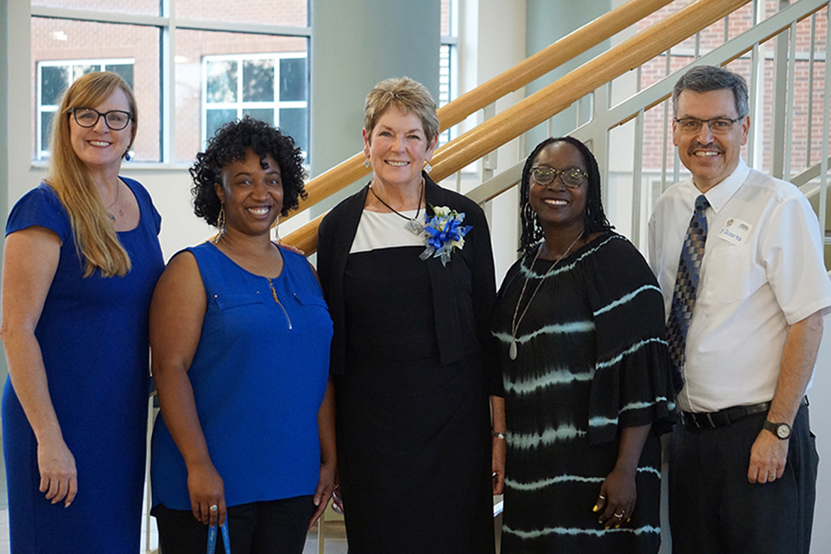 The faculty of the Professional Counseling Program poses at the Miller Education Building, where the June 15 reception celebrating the program's 50th anniversary, took place. They are, from left, Robin Lee, program director; Tiffany Wilson, assistant professor; Virginia Dansby, retiring coordinator of the school counseling concentration; Michelle Stevens, associate professor; and Chris Quarto, professor. (Submitted photo)