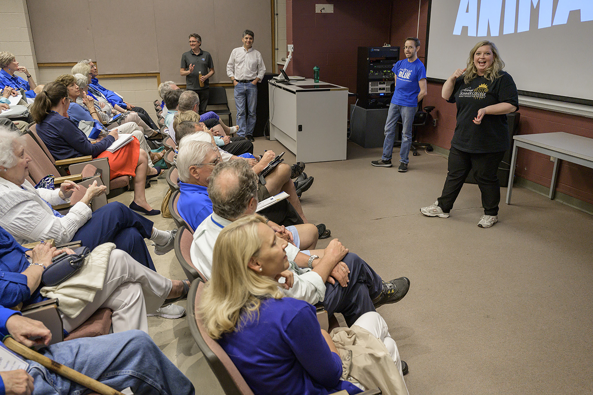 "MTSU Alumni Relations assistant director Rhonda King, right, welcomes the 12th annual Alumni Summer College attendees to the ""That's Entertainment"" session on animation recently in the John Bragg College of Media and Entertainment Building. The three-day event drew 75 alumni and friends of the university in June. (MTSU photo by Andy Heidt)"