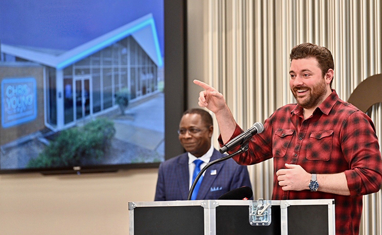 Multi-platinum country artist Chris Young, a former MTSU student, talks Tuesday July 9, about his decision to support the creation of a new live performance venue on the Murfreesboro university's campus, as President Sidney A. McPhee looks on. (MTSU photo by J. Intintoli)