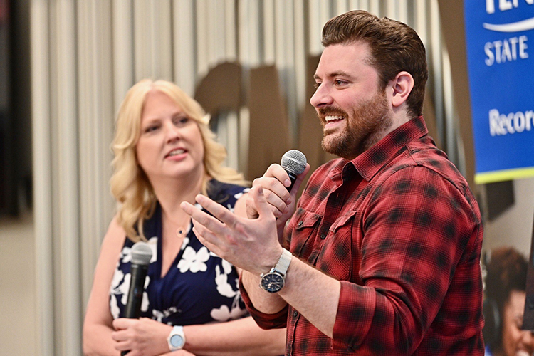 Multi-platinum country artist Chris Young, right, a former MTSU student, talks with Department of Recording Industry Chair Beverly Keel about his continued support of his alma mater. (MTSU photo by J. Intintoli)