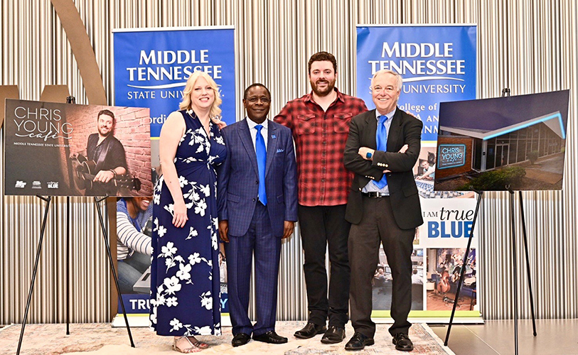 Multi-platinum country artist Chris Young, a former MTSU student, center right, joins President Sidney A. McPhee, center left; College of Media and Entertainment Dean Ken Paulson, right; and Department of Recording Industry Chair Beverly Keel Tuesday, July 9, to announce the Chris Young Café, a live performance venue on the Murfreesboro university's campus. (MTSU photo by J. Intintoli)