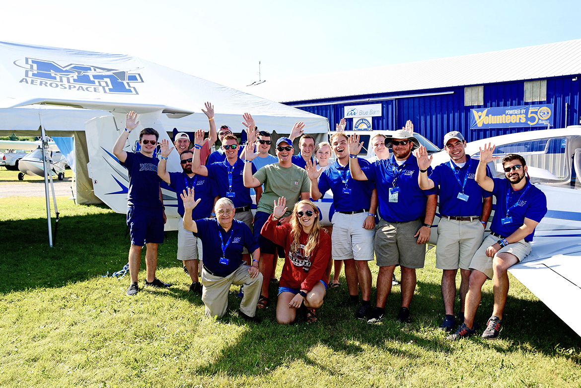 Students, alumni and flight instructors from MTSU's Department of Aerospace gather around a Diamond DA40 aircraft that the university flew to Oshkosh, Wis., for EAA AirVenture. (MTSU photo by Andrew Oppmann)