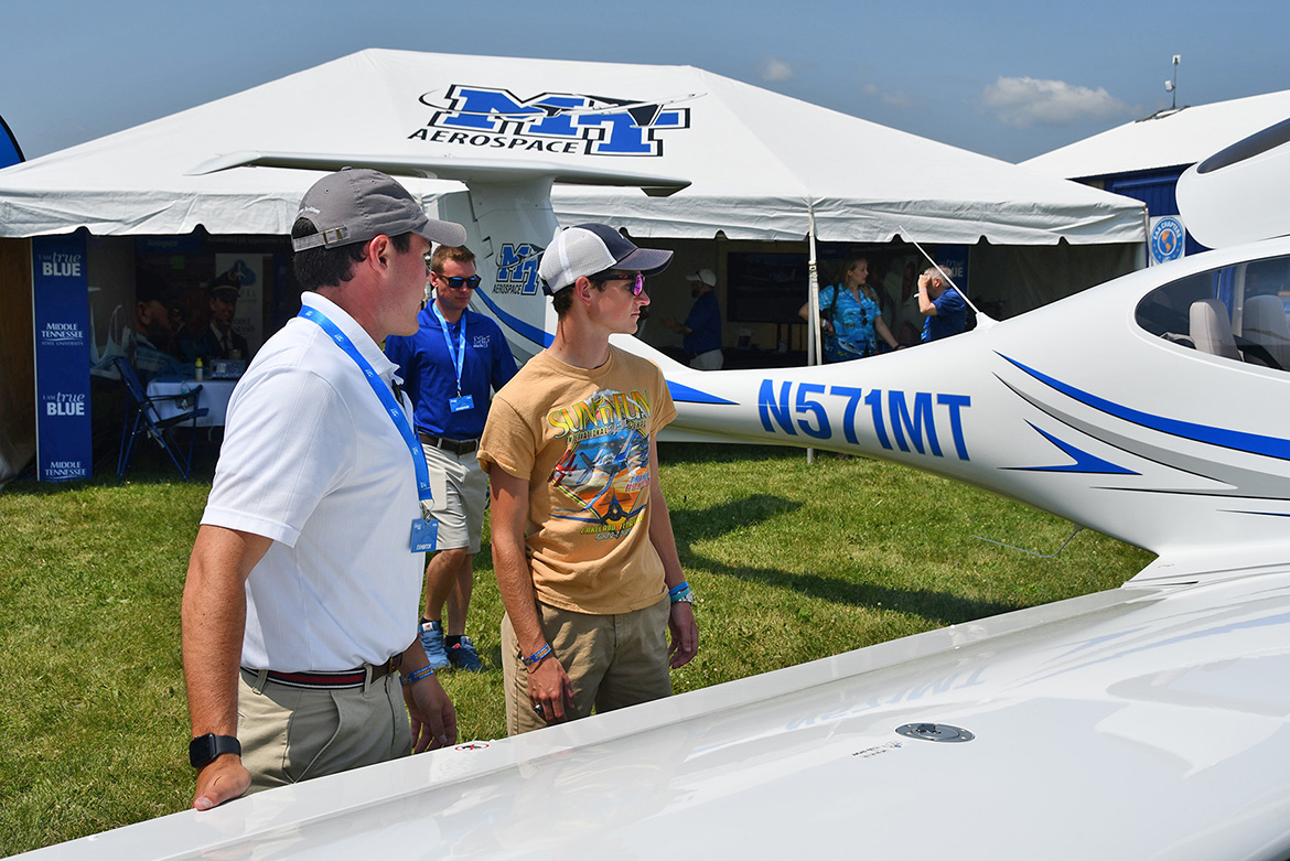 Ryan Hollinsworth, left, an MTSU flight instructor, shows one of the university's Diamond DA40 training aircraft to John Hitch of Crossville, Tenn., who will be attending MTSU in the fall and majoring in aerospace. (MTSU photo by Andrew Oppmann)