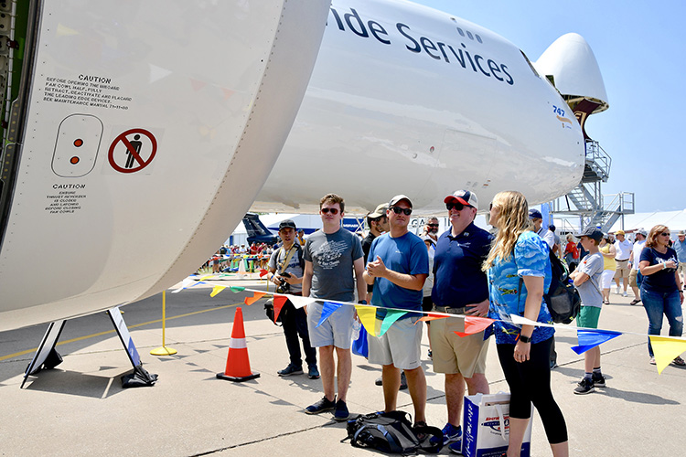 MTSU's Jackson Dalton, left, Charles Greenfield, second from left, and Elizabeth Keller, right, join 2015 aerospace alumnus Benton Beasley, now a captain for Endeavor Air, in looking at a special 747 modified for cargo used by United Parcel Service. (MTSU photo by Andrew Oppmann)