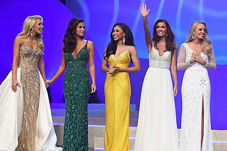 The top five finishers in the 2019 Miss Tennessee Volunteer Scholarship Pageant, which took place June 22 at the Carl Perkins Civic Center in Jackson, Tenn., acknowledge the crowd during the event. From left are second runner-up Noelle Thompson; pageant winner Kerri Arnold; fourth runner-up Elise Stein, a senior at MTSU; third runner-up Addison Hadley, also an MTSU senior; and first runner-up Kailey Jordan. (Submitted photo)