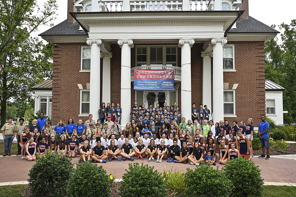About 40 visiting Chinese middle school students on Sunday were treated to an all-American picnic — and welcomed by cheerleaders and scouts — at the home of Middle Tennessee State University President Sidney A. McPhee. (MTSU Photo by Kimi Conro)