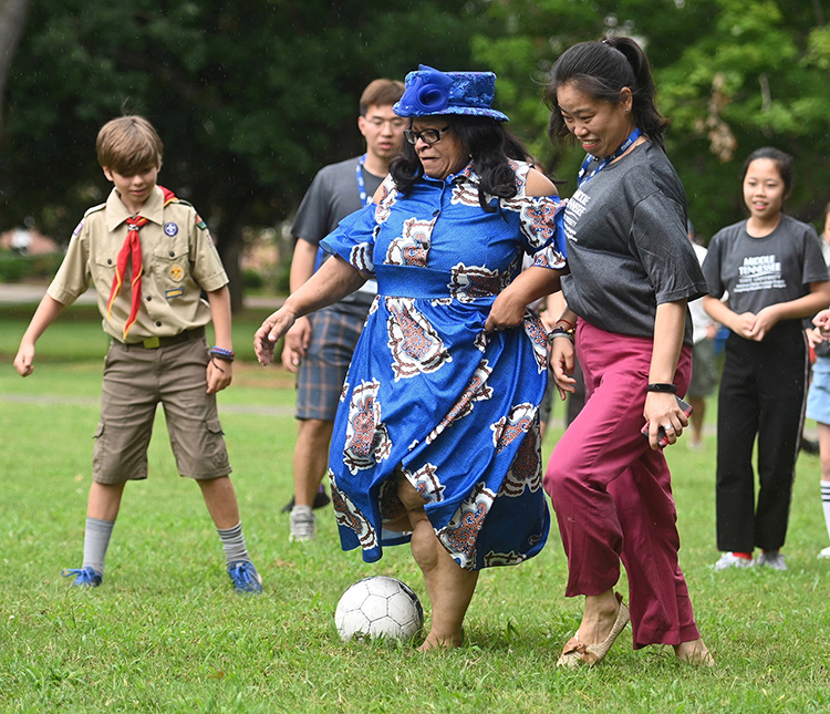 MTSU first lady Elizabeth McPhee, center in hat, plays soccer Sunday on the lawn of the President's Residence on campus with members of the delegation from China's Dongcheng Education Group. MTSU President Sidney A. McPhee and his wife hosted the group of middle school students for a picnic as part of their cultural exchange visit. (MTSU photo by Kimi Conro)