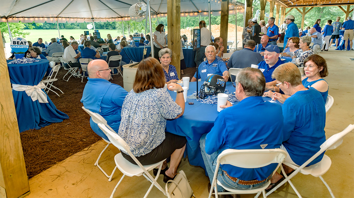 """MTSU alumni and friends enjoy food, beverages and conversation during the 2018 Pigskin Pregame last August at Hop Springs Beer Park, which is partnering with MTSU fermentation science. This year's """"Pigskin"""" will be held at 6 p.m. Saturday, Aug. 10, at the home of Jonathan Harmon, 746 E. Main St., in Murfreesboro. The deadline to register is Aug. 2. (MTSU file photo by Eric Sutton)"""