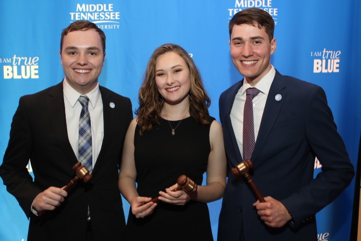 SGA senators Kobe Hermann, Emily Oppmann, and Tommy Wilmore, holding their gavels following the 2019 CSIL/SGA Awards Banquet