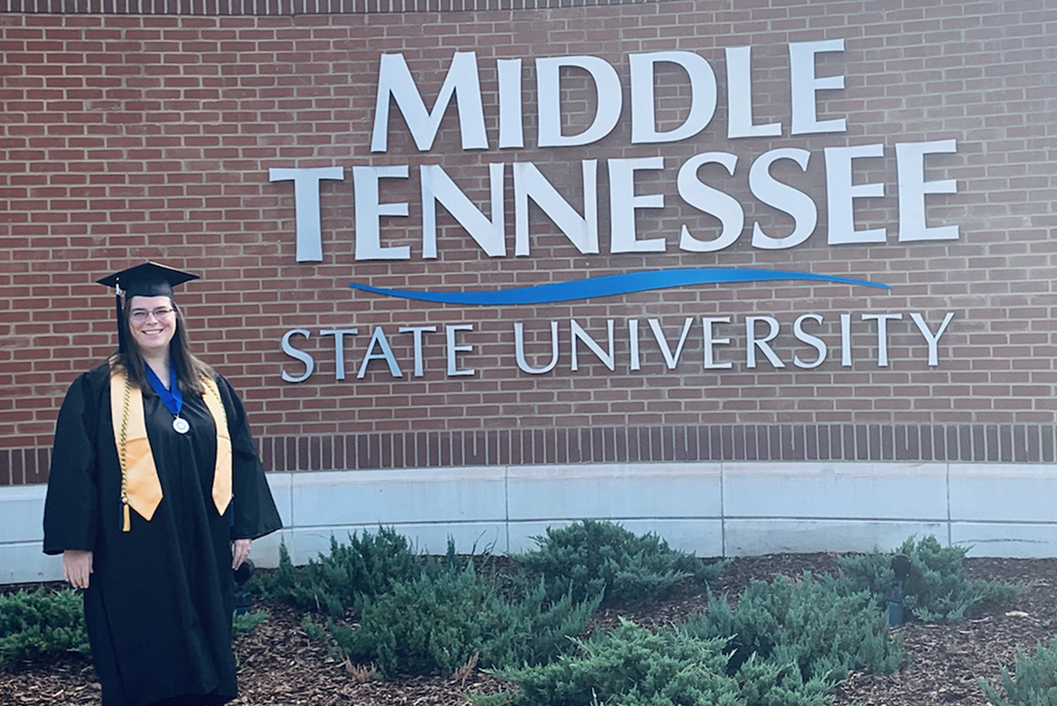 MTSU adult learner Ashley Pearson, who just received her bachelor's degree in integrated studies, stands on the campus of Middle Tennessee State University after the August 2019 commencement ceremony. (Submitted photo)
