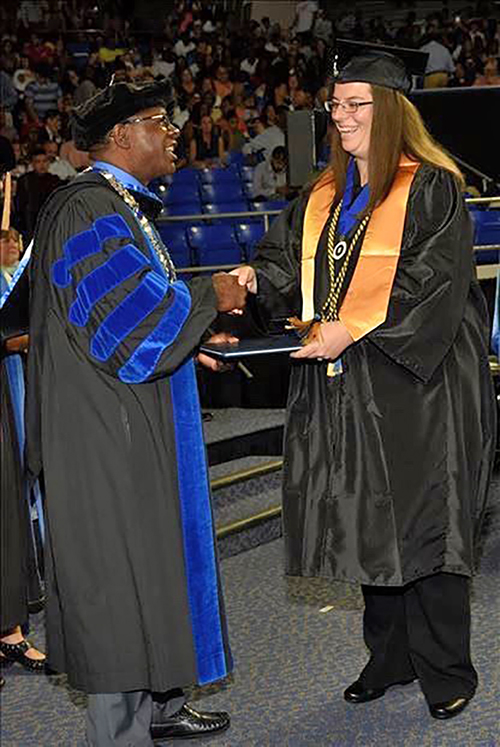 Integrated studies graduate Ashley Pearson receives her degree from MTSU President Sidney A. McPhee during the August 2019 commencement ceremony at Murphy Center. (Photo by Grad Images)