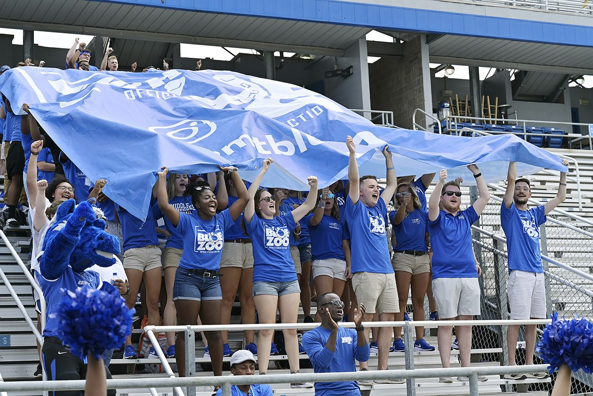 Officers and founders of the Blue Zoo, the newly revived student pep group at MTSU, stand in the first row of more than 300 students holding aloft the organization's banner for the first time at an event Tuesday, Aug. 13, at Floyd Stadium. (MTSU photo by Andy Heidt)