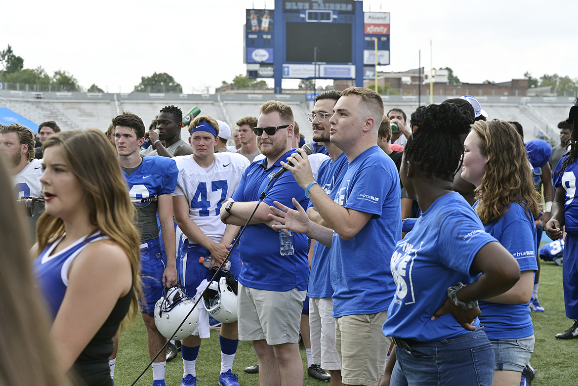 Kobe Hermann, president of the Blue Zoo, the newly revived student pep group at MTSU, speaks to the more than 300 students assembled Tuesday, Aug. 13, at Floyd Stadium to unfurl the organization's banner for the first time. (MTSU Photo by Andy Heidt)