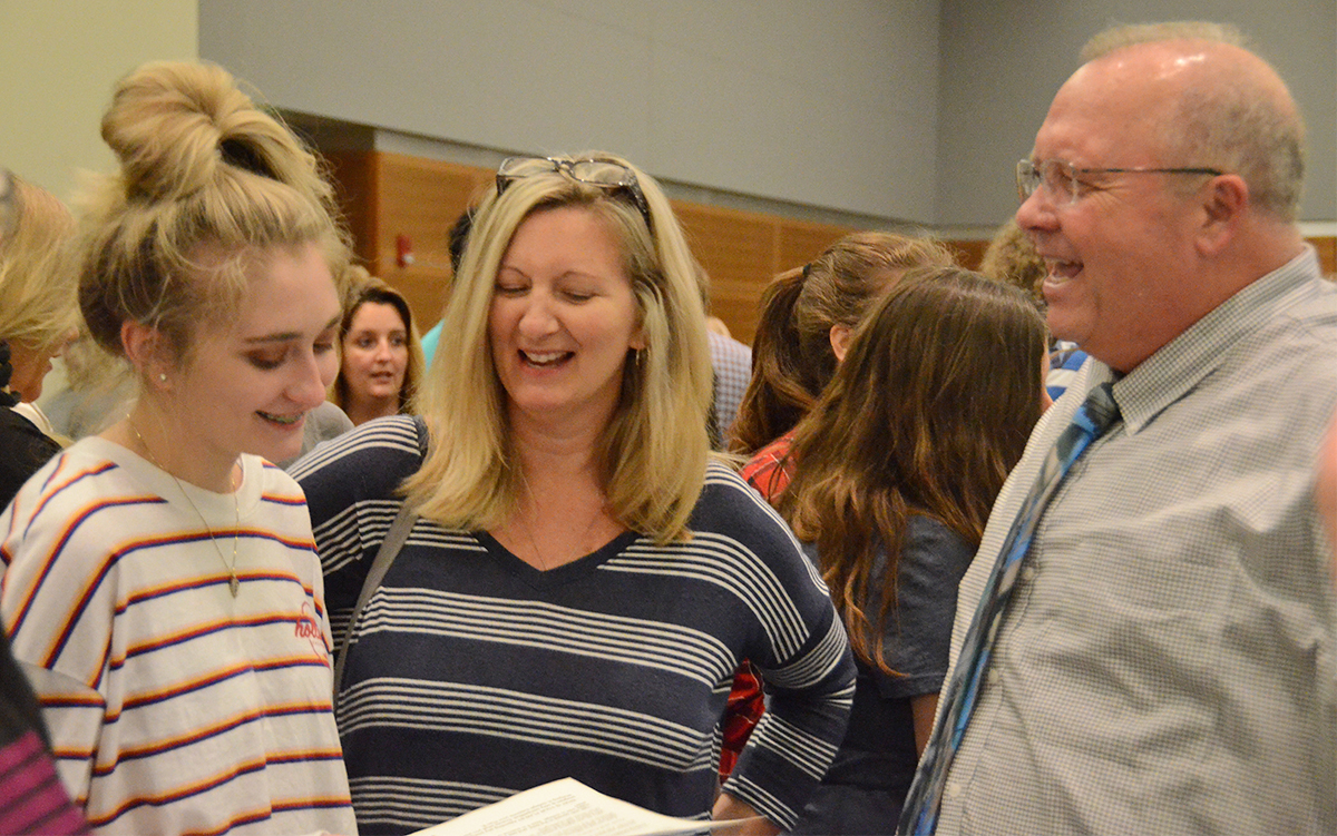 MTSU College of Basic and Applied Sciences Dean Bud Fischer, right, laughs along with a prospective student and her mother while discussing science opportunities in August 2018 during the annual Rutherford County College Night at MTSU. This year's event, which is free, is from 6 to 8 p.m. Wednesday, Sept. 4, in the Student Union Ballroom, with 50 colleges and universities participating. (MTSU file photo by Randy Weiler)