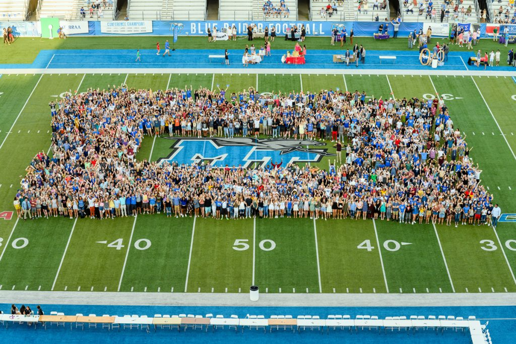 The 2019-20 MTSU freshman class — the Class of 2023 — gathers on Horace Jones Field in Floyd Stadium for a group photo as part of University Convocation, the President's Picnic and MT Athletics Fan Day Saturday, Aug. 24. (MTSU photo by J. Intintoli)