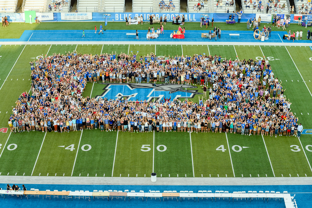The 2019-20 MTSU freshman class — aka Class of 2023 — gathers on the turf of Horace Jones Field in Floyd Stadium for a group photo as part of University Convocation, the President's Picnic and MT Athletics Fan Day Saturday, Aug. 24. (MTSU photo by J. Intintoli)