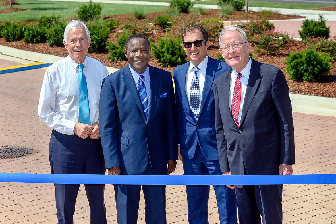 MTSU and the city of Murfreesboro hosted a ribbon-cutting Friday, Aug. 2, to celebrate the completion of an $18.2 million renovation project to Middle Tennessee Boulevard. Preparing to cut the ribbon, from left, are former Congressman Bart Gordon, MTSU President Sidney A. McPhee, Murfreesboro Mayor Shane McFarland and U.S. Sen. Lamar Alexander. (MTSU photo by J. Intintoli)