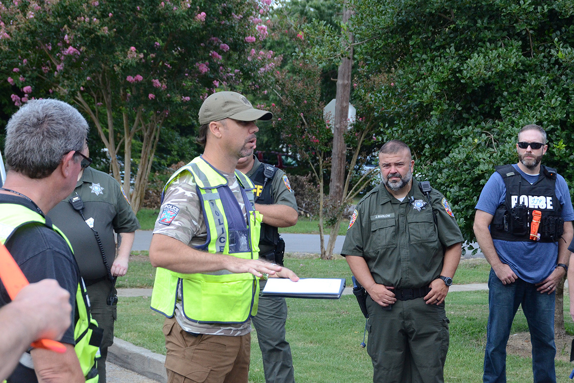 MTSU Police Capt. Jeff Martinez, center left, debriefs a group of about 30 emergency responders from throughout Rutherford County following a training session scenario at MTSU held in early August as part of a comprehensive course to train more than 1,200 emergency responders on better coordination across the county by the end of the year. Martinez is among the instructors teaching the courses. (MTSU photo by Jimmy Hart)