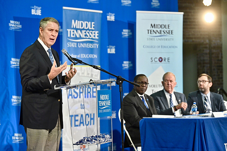 Former U.S. Senate Majority Leader Bill Frist, SCORE founder and chairman, talks about the agreement signed Wednesday, Aug. 28, between Middle Tennessee State University and SCORE (State Collaborative on Reforming Education) that seeks to improve teacher training within the university's College of Education. Looking on, seated from left, are MTSU President Sidney A. McPhee, MTSU Board of Trustees Chairman Stephen Smith and SCORE President and CEO David Mansouri . The signing was held at Homer Pittard Campus School, a K-5 teaching laboratory school owned by MTSU and operated by Rutherford County Schools. (MTSU photo by J. Intintoli)