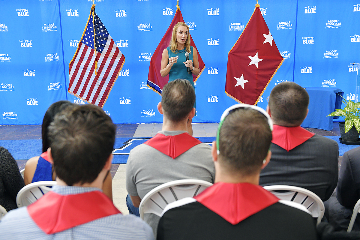 Hilary Miller, director of the Charlie and Hazel Daniels Veterans and Military Family Center, talks with graduating veterans about their looming alumni role during the Graduating Veterans Stole Ceremony Thursday, Aug. 1. (MTSU photo by Andy Heidt)
